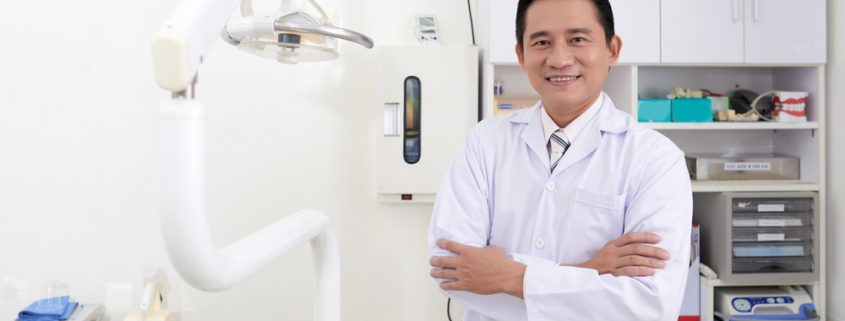 A Dentist Standing in his Clinic